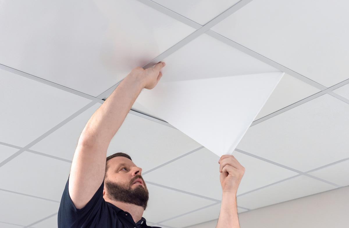Man Peeling the SmartPeel Nova Ceiling Tile